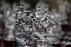 Many champion silver trophy for Extreme Sport Motorcycle,The motocross competition Stock Photos