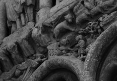 So many characters on the church entrance. Shot in black and white detail of the sculpture on the facade of this historic building cathedral representing some Stock Photos