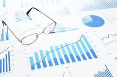 Many charts and glasses. Reviewing data. Royalty Free Stock Photos