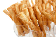 Many cheese pastry twists in wine glasses. And white background Royalty Free Stock Image
