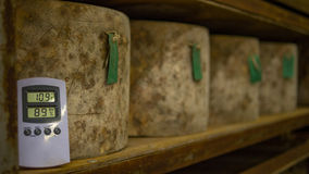 Many cheese wheels being stored in a Cheese Cathedral. Cheese wheels being stored in a cheese cathedral over a very long period of time, once the cheese has Stock Images