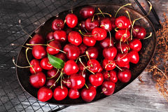 Many cherries black plate top berries Royalty Free Stock Photos