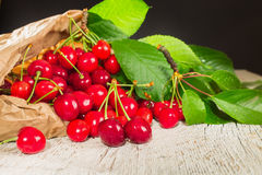 Many cherries in a paper bag Stock Photos