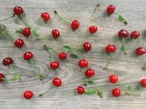 Many cherries on wooden background royalty free stock photography