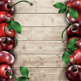 Many cherries on wooden texture background. Royalty Free Stock Images