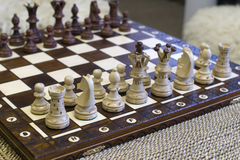 Many chess piece figures standing on chess board Royalty Free Stock Photos
