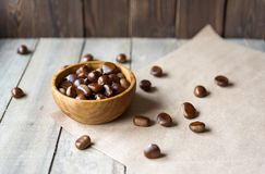 Many chestnuts in a wooden bowl stock photos