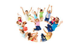 Many children in circle with boy center lift hands Royalty Free Stock Photos