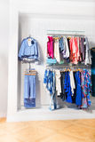 Many children clothes in store on white wall Stock Images
