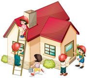 Many children constructing the house Stock Photos