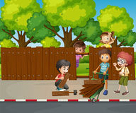 Many children fixing wooden fence together Stock Image