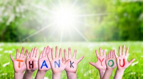 Free Many Children Hands Building Word Thank You, Grass Meadow Royalty Free Stock Photo - 183503115