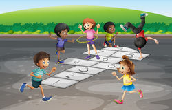 Many children playing hopscotch in the park Stock Photography