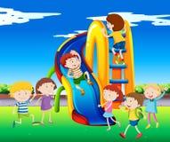 Many children playing on slide Stock Photo