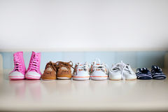 Many children's shoes. On a neutral background stock images