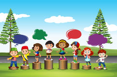 Many children standing on logs Royalty Free Stock Image