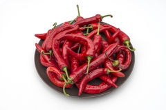 Many chili peppers on plate  Stock Photos