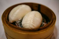 Chinese buns cooked in a traditional bamboo steamer. royalty free stock images