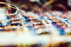 Many chips waiting to be soldered onto a board Stock Images