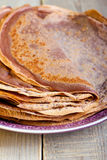 Many chocolate crepes Stock Images