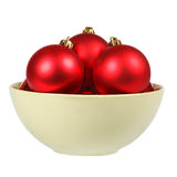 Many Christmas balls on a dish. Object on a white background Royalty Free Stock Image