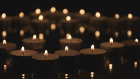 Many Christmas Candles Burning in The Dark. stock footage