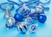 Many Christmas decorations toys on light blue Royalty Free Stock Photography