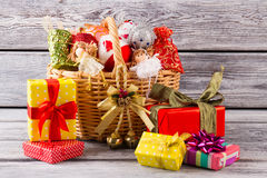Many Christmas gifts near the basket with balls. Preparation for Christmas. Beautiful decorations for the home Stock Photography