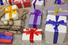 Many Christmas gifts Plaid new year Royalty Free Stock Photography