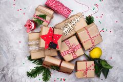 Many Christmas gifts on stone background. Top view royalty free stock photography