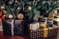 Many christmas gifts under fir tree close up. Holiday composition Royalty Free Stock Photo