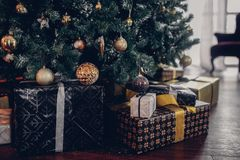 Many christmas gifts under fir tree close up. Holiday composition Stock Photography