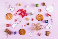 MANY CHRISTMAS ORNAMENTS. DECORATIVE ELEMENTS ON PINK BACKGROUND. MERRY CHRISTMAS. DECORATIVE ELEMENTS OVERHEAD PHOTO. BEAUTYFUL ORNAMENT TOOLS STILL LIFE Royalty Free Stock Photo