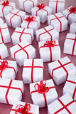 Many christmas presents with red ribbons Stock Images