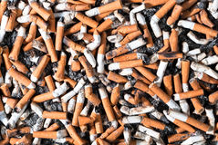 Many cigarette butts. Many filter cigarette butts background Royalty Free Stock Images