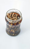 Many cigarette butts in a bottle covered Royalty Free Stock Photo