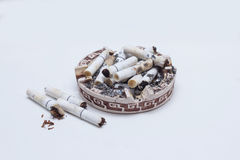 Many cigarette cigarettes in an ashtray. Many extinguished cigarette cigarettes in an ashtray Royalty Free Stock Photography