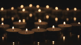 Many Cinemagraph Candles Burning in The Dark. Cinemagraph many decorative candles burning in the dark. Beautiful romantic video. Golden light of candle flame stock video footage