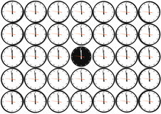 Many clocks. On the white wall Royalty Free Stock Images
