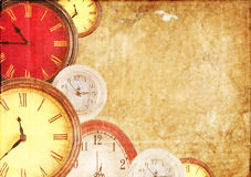 Many clocks on a paper background Stock Images