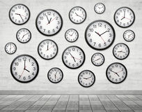 Many Clocks on wall. Mean time is important Royalty Free Stock Photography