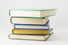 Many closed books lying on a white background. Horizontal stock image