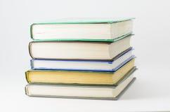 Many closed books lying on a white background. Horizontal royalty free stock image