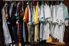 Many cloth in closet stock photography