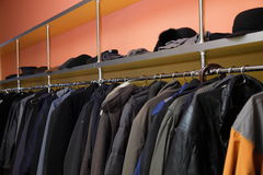 Many clothes in cloakroom Royalty Free Stock Images
