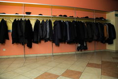 Many clothes in cloakroom Royalty Free Stock Photos
