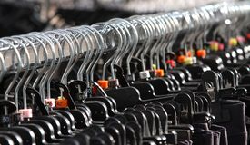 Many clothes hangers and clothes for sale Stock Photography