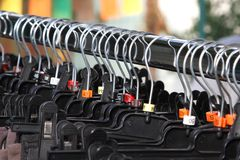 Many clothes hangers and clothes shopping centre for sale Royalty Free Stock Photography