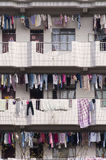 Chinese dormitory, apartment. Many clothes hanging over balcony at Chinese dormitory, apartment royalty free stock photo