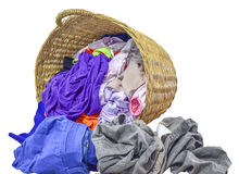 Many clothes with in wicker basket on isolated white background.  stock image